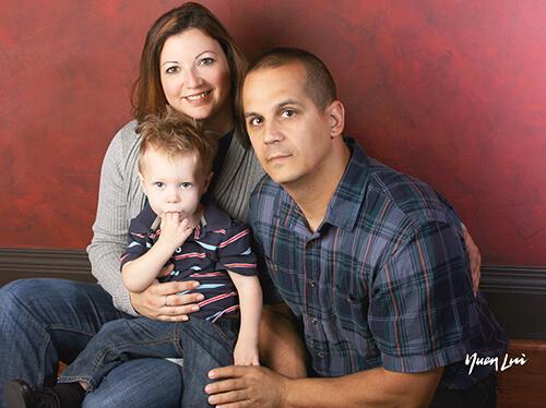 Adam, La Donna, and their son.