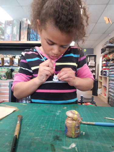 child painting miniatures