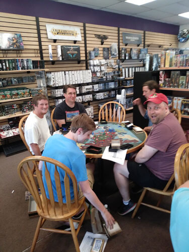 group playing board game